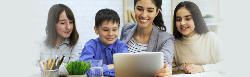 teacher-holding-tablet-with-students