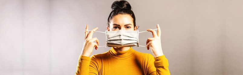woman-holding-a-facemask