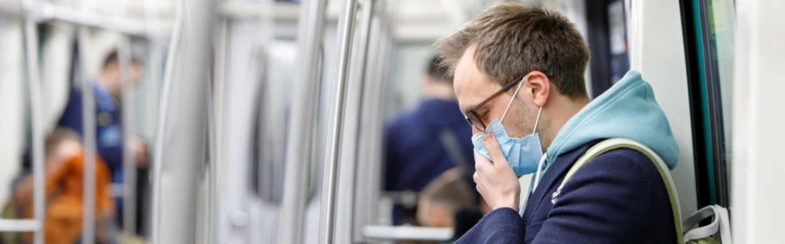 man-with-face-mask-during-transportation